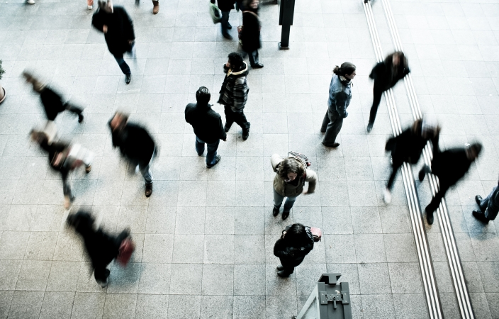 people walking on grey concrete floor during daytime - Source: Photo by Timon Studler on Unsplash