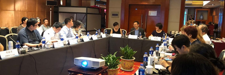 Panel of speakers discussing and collaborating at the ACC in Beijing