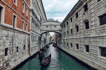 gondola ride on Venetian canal in a European city