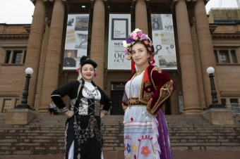 'Erifili Kandylas (left) wears a traditional Greek outfit from the Corfu region, while Kiriaki Mandarakas wears an authentic Greek outfit from Macedonia, outside of the State Library of NSW.'