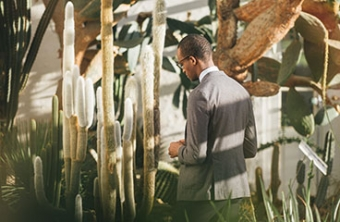 Man walking through modern garden