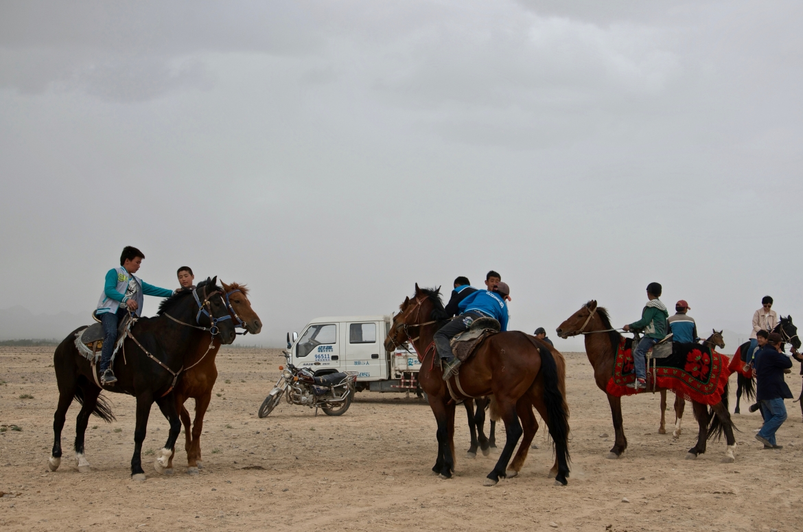 Young Kyrgyz riders getting ready for the annual horse game ulak tartish. Atush, Xinjiang Uyghur Autonomous Region, China.​