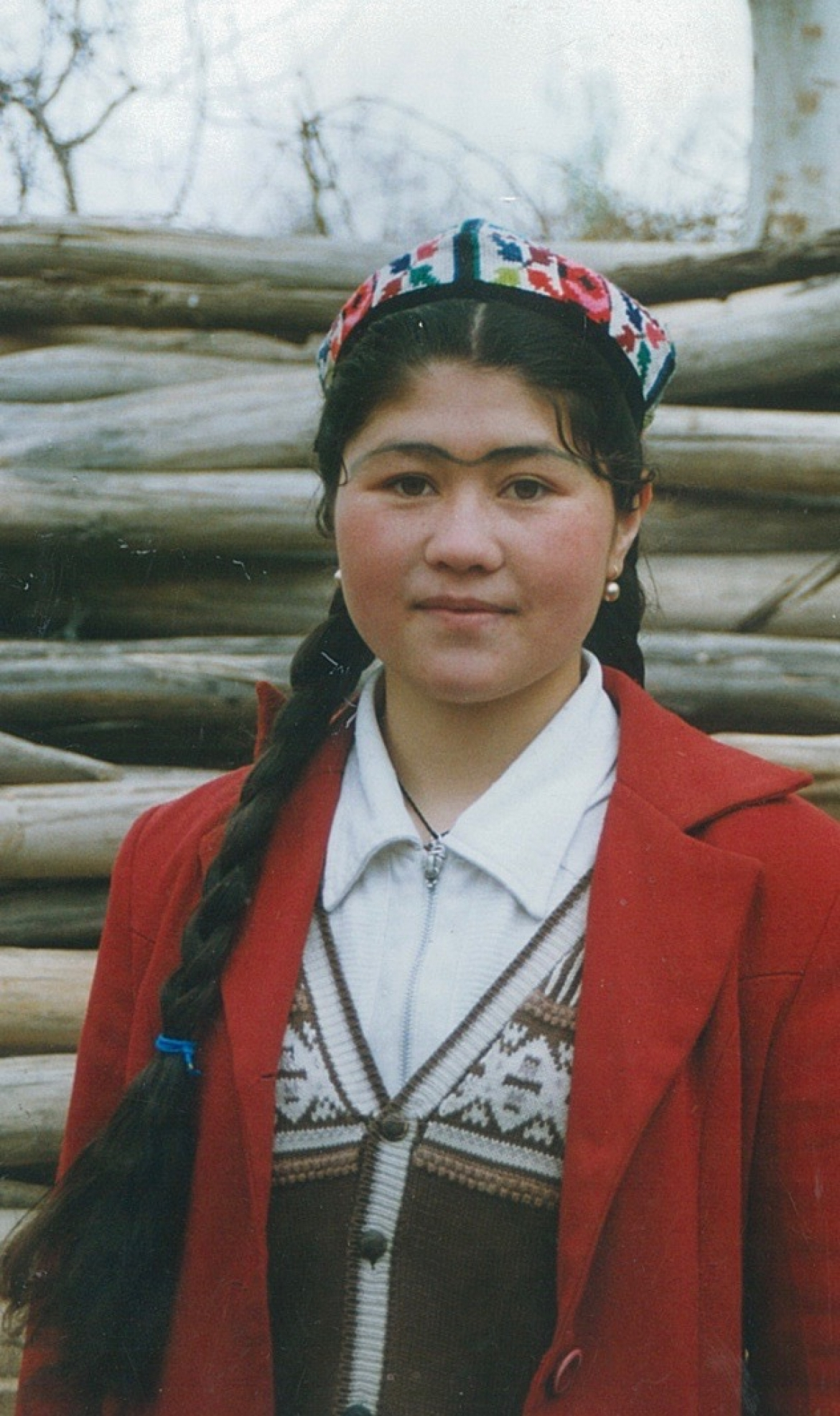 Uyghur girl wearing a dopa, Uyghur traditional hat, and eyebrows painted with osma, a herb said to help shape and thicken the eyebrows. Kashgar, Xinjiang Uyghur Autonomous Region, China.​