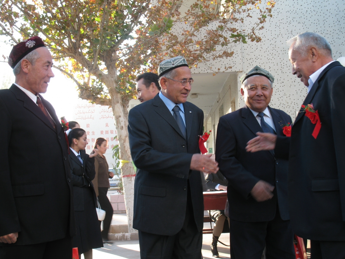 Uyghur high school teachers greet one another at a school ceremony, Kasghar, Xinjiang Uyghur Autonomous Region, China. ​