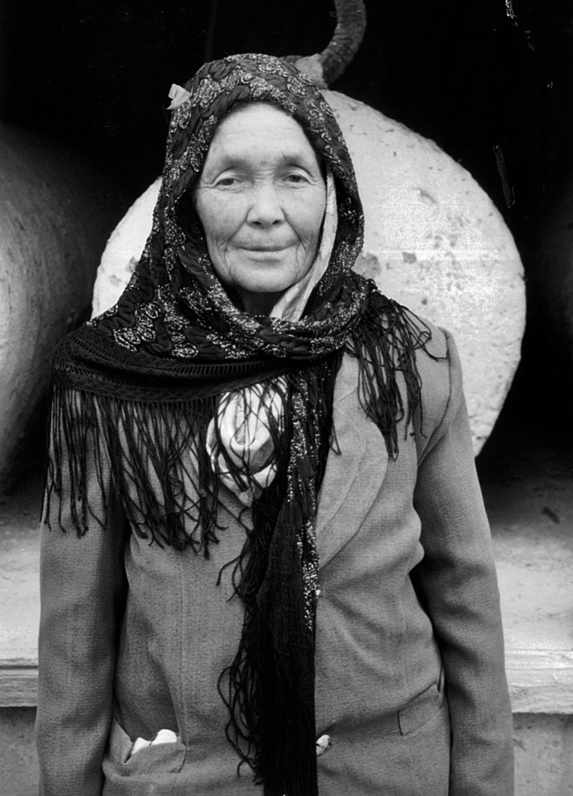 Uyghur woman in front of a saint's tomb/mazar, Kashgar, Xinjiang Uyghur Autonomous Region, China.​
