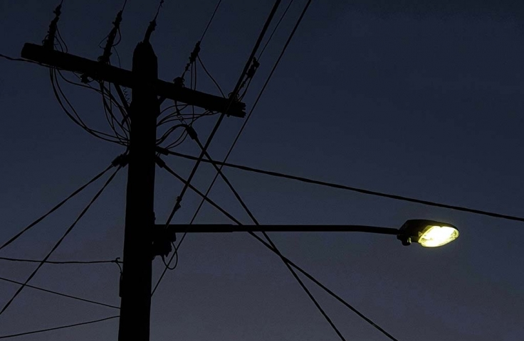 night photo of street light and electrical wires