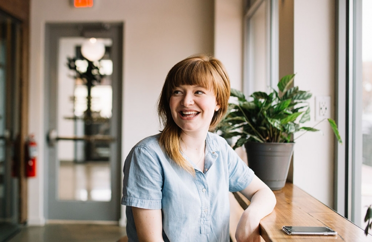 Smiling woman in office looking to the left