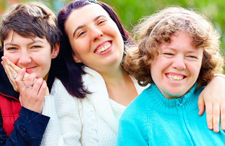 Happy women with disabilities smiling in a group