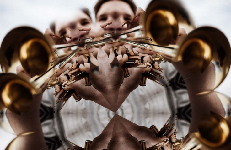 a trumpet player as if seen through a kaleidoscope