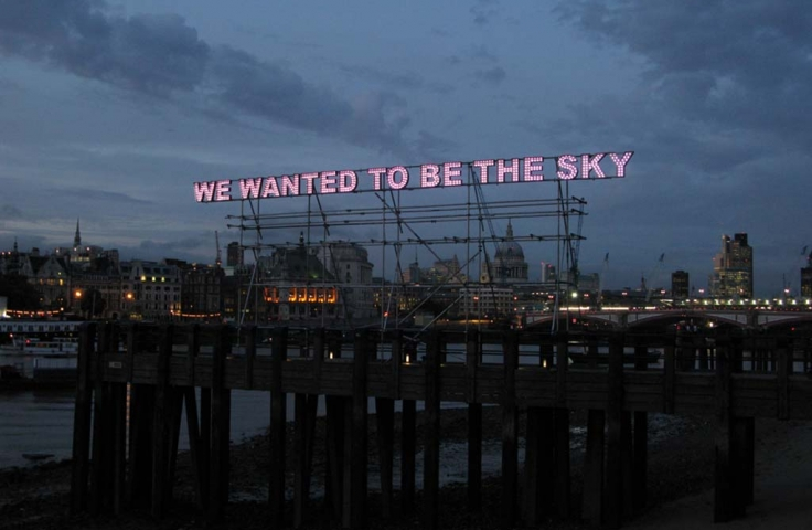 Sign in lights which reads, 'we wanted to be the sky'