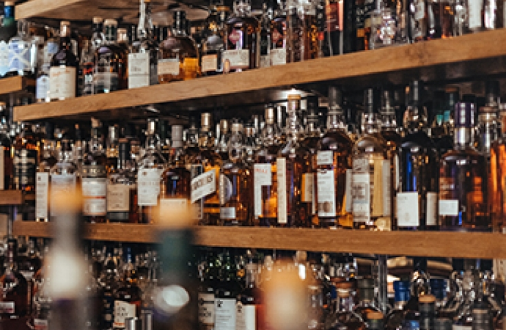 Shelves of bottles of alcohol in bar