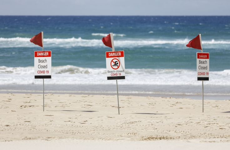 beach closed coronavirus sign