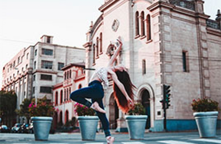 Dance student dancing in outdoor city setting