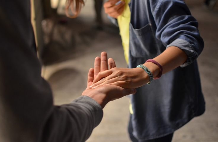 Person with a physical disability interacting with another person in disability support program