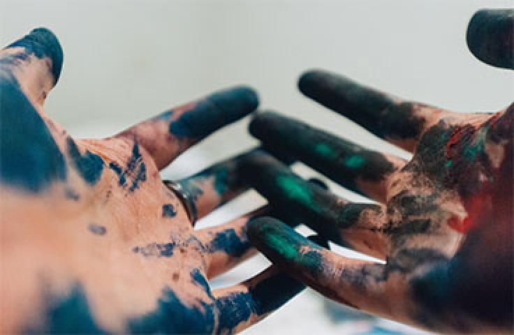 Arts students hands covered in paint