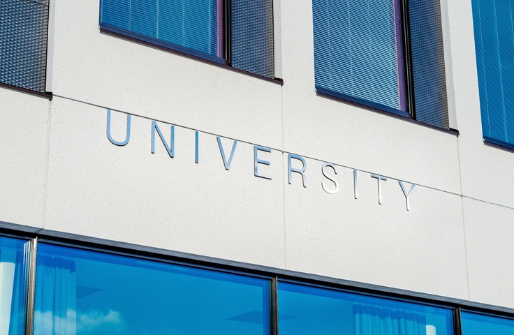 university sign indicating higher education