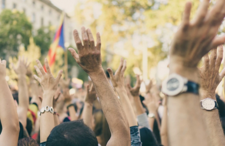 Hands in the air at a group rally or protest