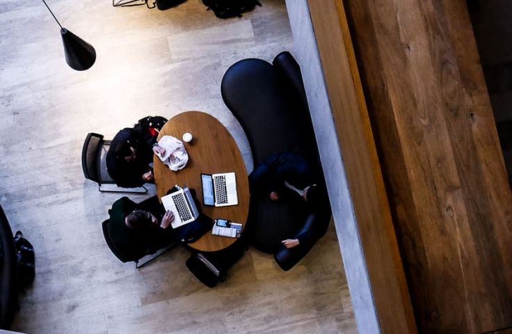 Students studying in quiet study pods on campus reviewing education coursework